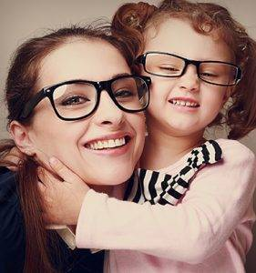 Loving happy mother and smiling daughter hugging. Vintage closeup portrait